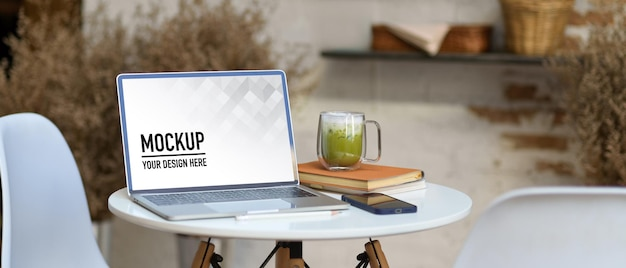 Close up of portable workspace with laptop mockup Premium Psd