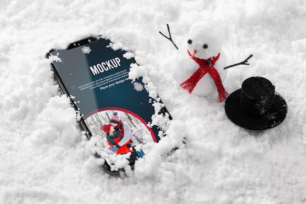 Close up smartphone in snow Free Psd