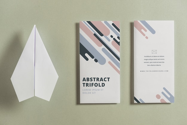 Closed trifold brochure mockup with paper plane Free Psd