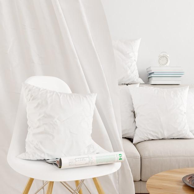 Closeup of white pillowcase on a modern chair mockup Free Psd