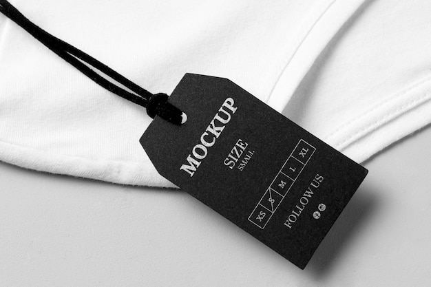 Размер одежды черный макет высокого вида и белое полотенце Бесплатные Psd