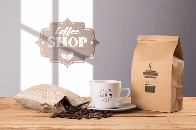 Coffee bag with cup beside Free Psd