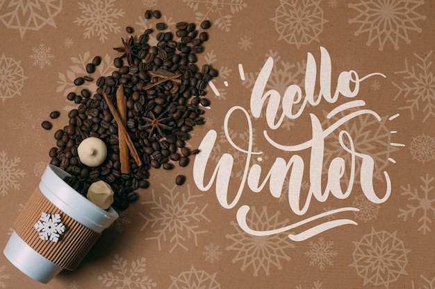 Coffee beans in a cup with hello winter greeting Free Psd