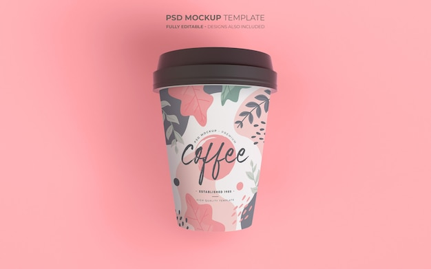 Coffee cup mockup with floral design Free Psd