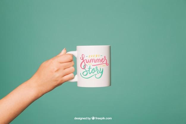 Coffee mug mockup with arm Free Psd