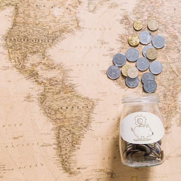 Coins on world map Free Psd