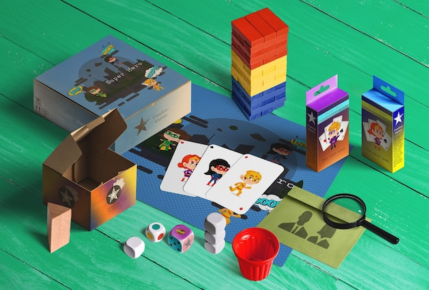 Collection of toys for kids. jenga, cards, magnifying glass, dice, cardboard box Free Psd