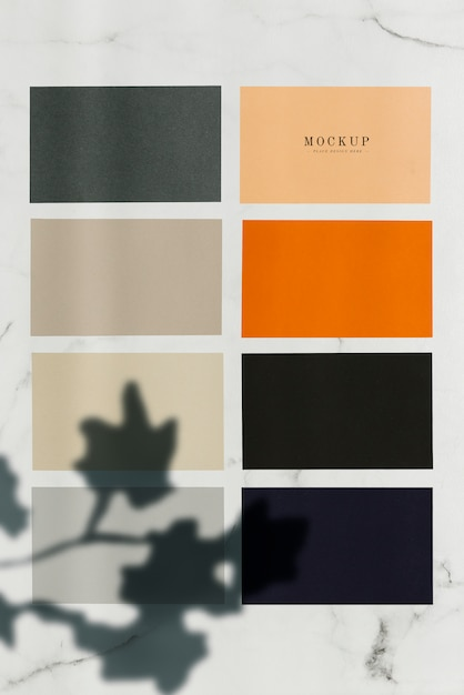 Colored sample paper square mockups on a marble table Free Psd