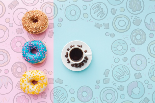 Colorful donuts and black coffee Free Psd