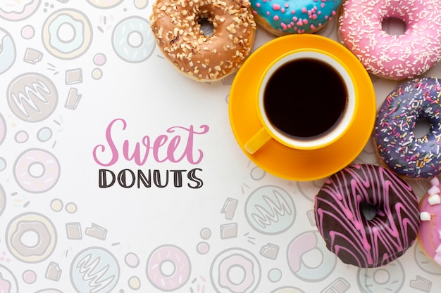 Colorful donuts and coffee with mock-up Free Psd