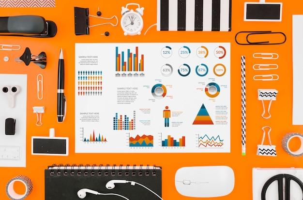 Colorful graphics mock-up on orange background Free Psd