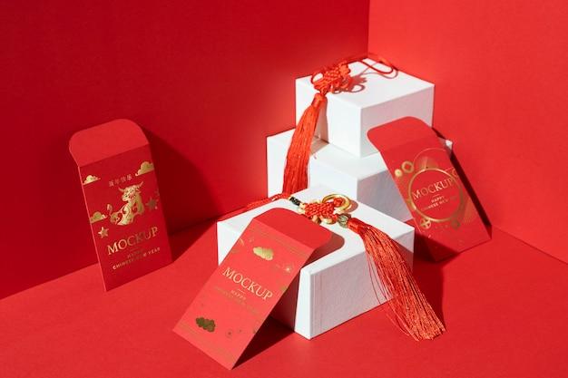 Composizione di elementi di mock-up del capodanno cinese Psd Gratuite