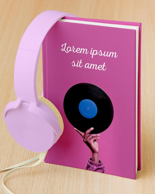 Composition with book cover mock-up and headphones