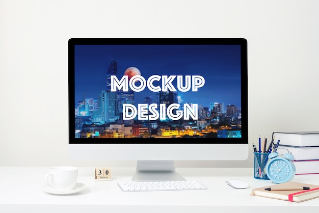 Computer display for mockup on white desk at the office. Premium Psd