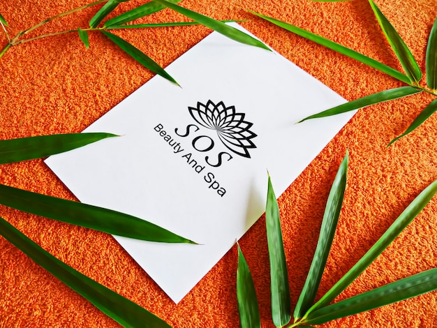 Concept mockup of spa bamboo leaves and towel Premium Psd