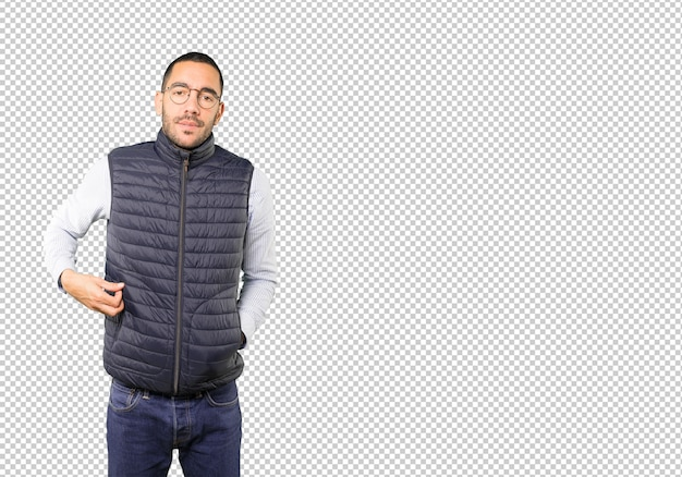 Concerned young man making a gesture of being cold Premium Psd