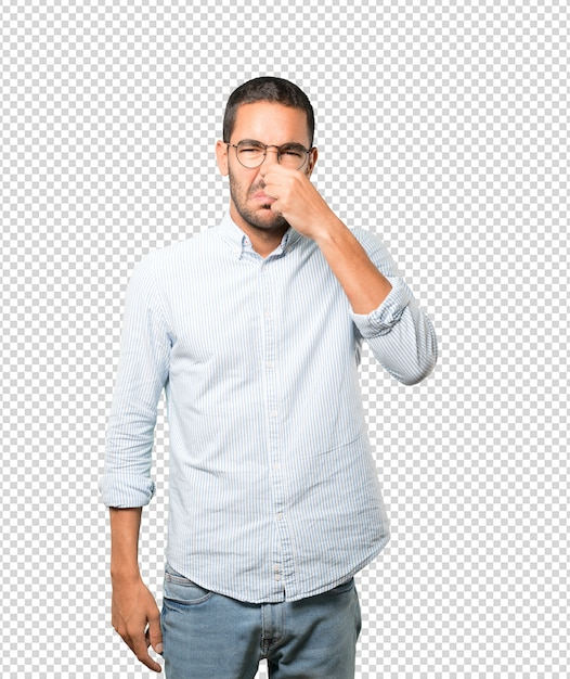 Concerned young man with a gesture of disgust Premium Psd