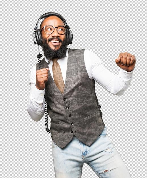 Cool black man with headphones dancing Premium Psd