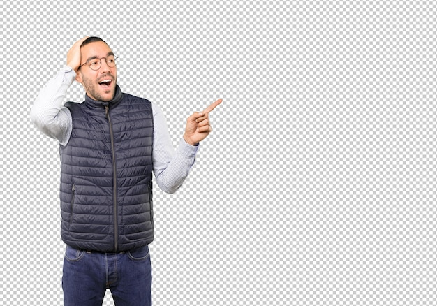 Cool young man pointing with his finger Premium Psd