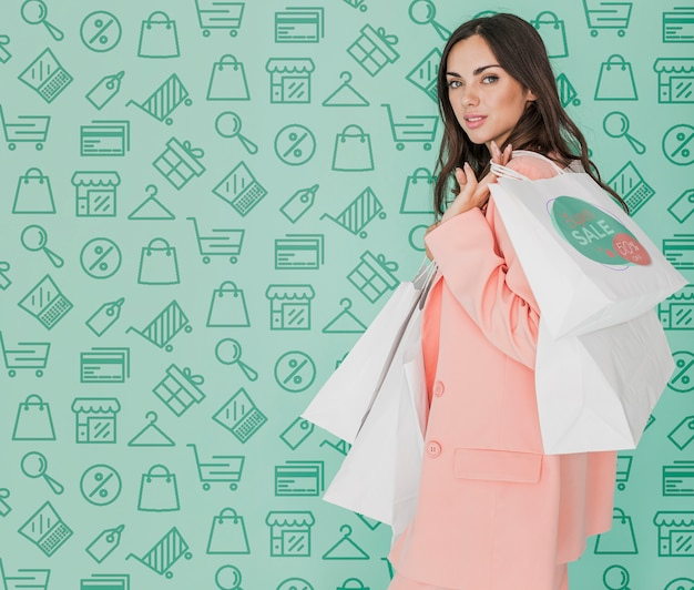 Copy-space beautiful woman holding shopping bags Free Psd