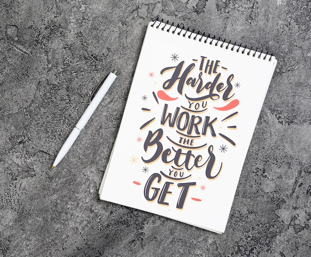 Copy-space notebook with inspirational message Free Psd