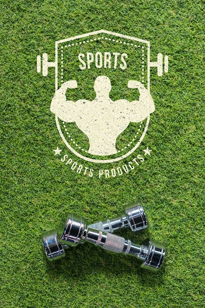 Copyspace mockup on grass with dumbbells Free Psd