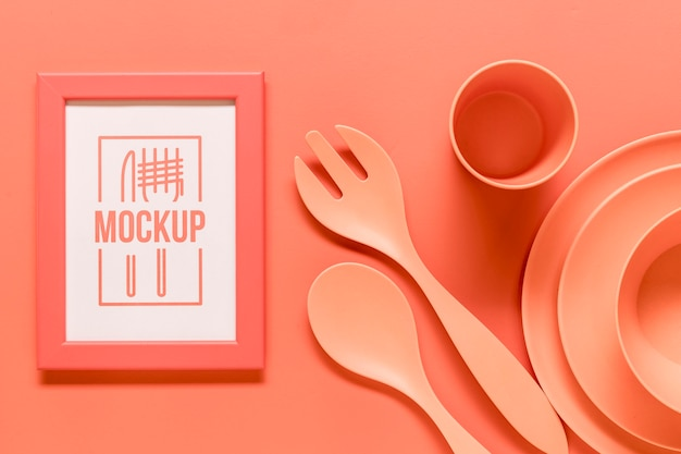 Coral arrangement with frame mock-up and kitchen tableware Premium Psd