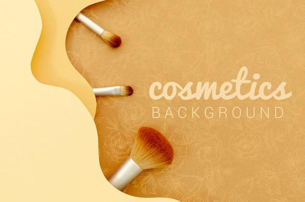 Cosmetics background with brush set Premium Psd