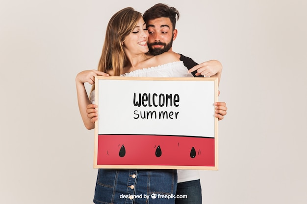 Couple presenting whiteboard Free Psd