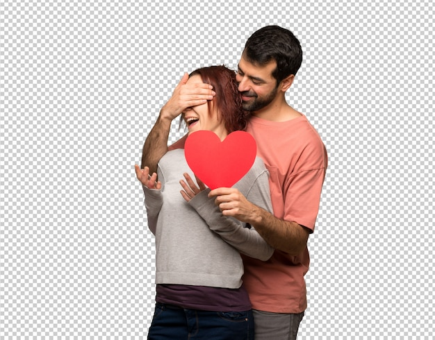Couple in valentine day holding a heart symbol Premium Psd