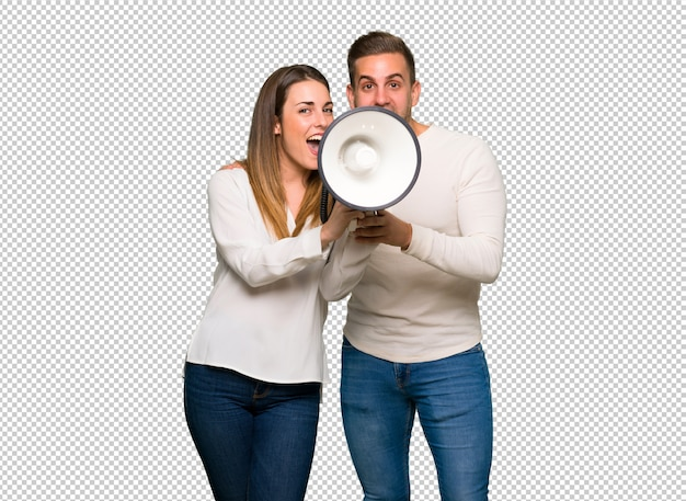 Couple in valentine day shouting through a megaphone Premium Psd