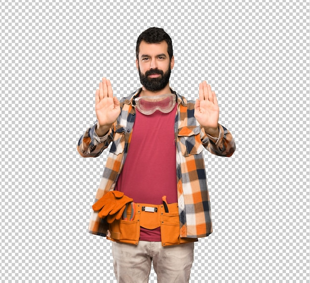 Craftsmen man making stop gesture and disappointed Premium Psd