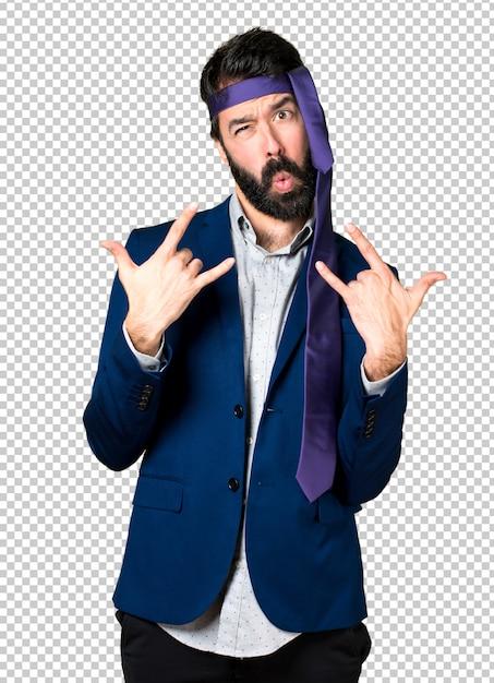 Crazy and drunk businessman making horn gesture Premium Psd