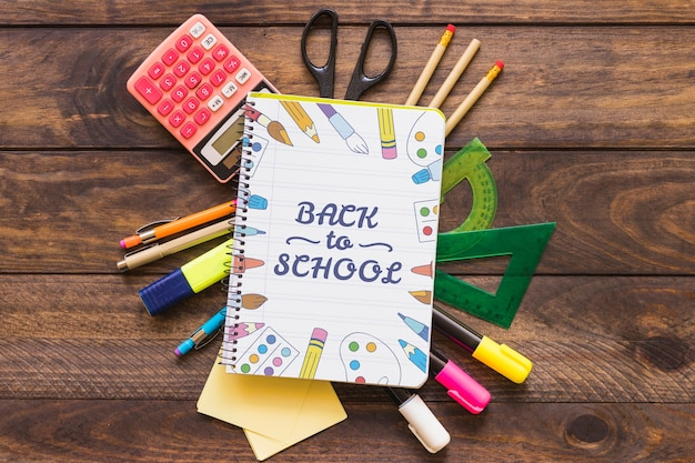 Creative notebook mockup with back to school concept Free Psd