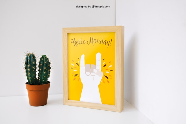 Creative photo frame mockup with cactus Free Psd