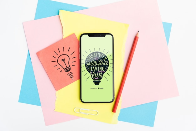 Creativity is intelligence having fun quote on mobile phone Free Psd