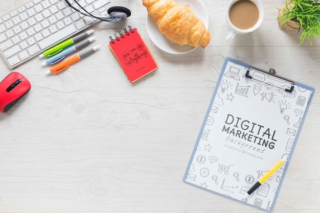 Croissant coffee desk stuff and notebook mock-up Free Psd