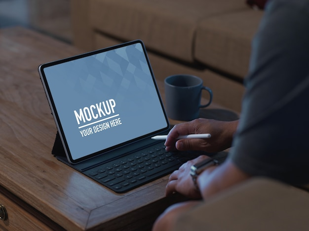 Cropped shot of male using mock up digital table with stylus Premium Psd