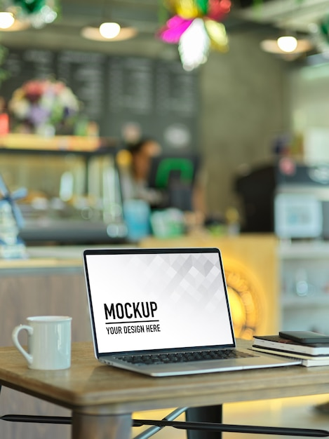 Cropped shot of portable workspace with laptop mockup Premium Psd