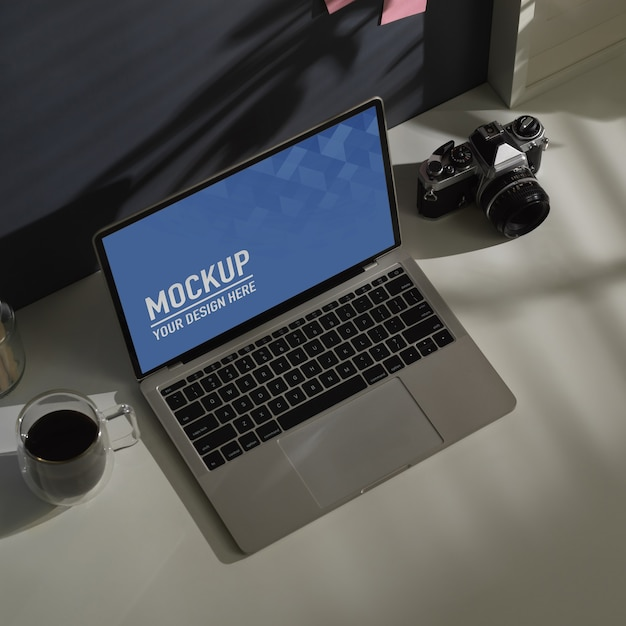 Cropped shot of worktable with laptop mockup Premium Psd
