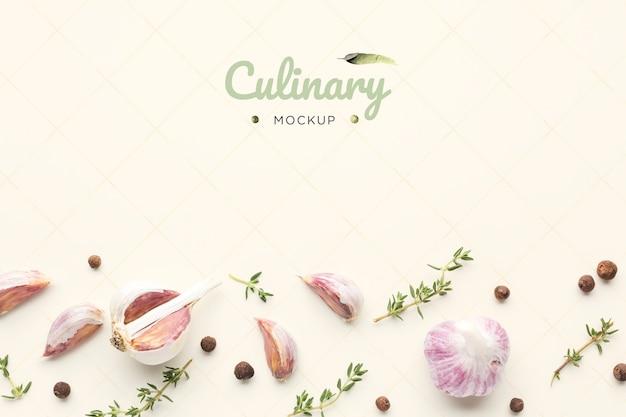 Culinary garlic mock-up with herbs Free Psd