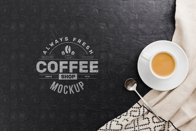 Cup of coffee on cloth mock-up Premium Psd