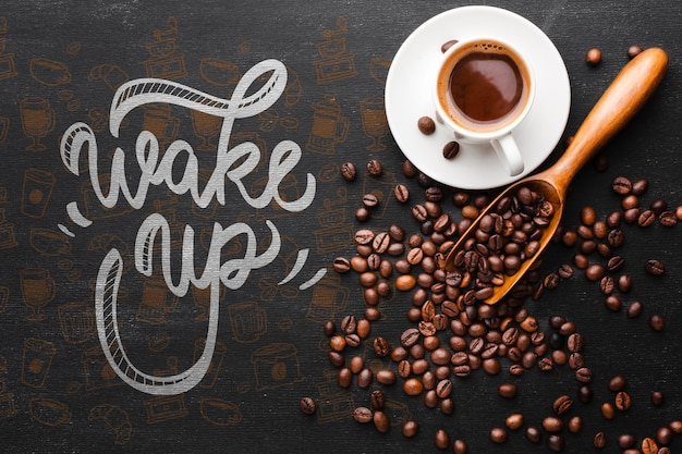 Cup of coffee and coffee beans background Free Psd