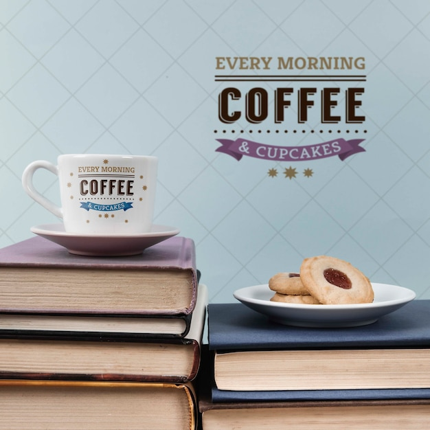 Cup of coffee and cookies on a pile of books Free Psd