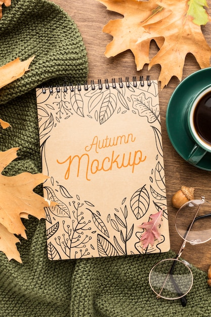 Cup of coffee with notebook Free Psd