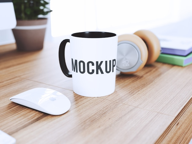 Cup on desk mock up Free Psd