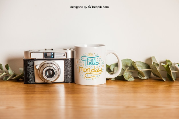 Cup mockup and camera Free Psd