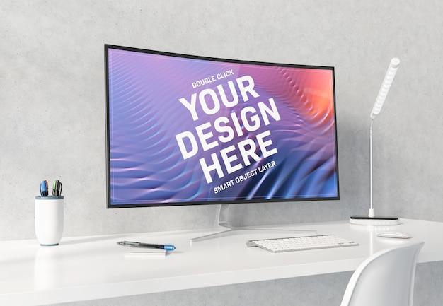 Curved monitor on white desktop mockup Premium Psd