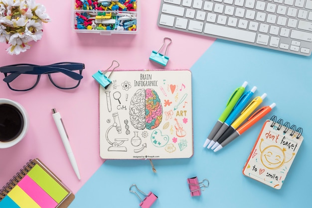 Cute business desk design with notebook mock-up Free Psd