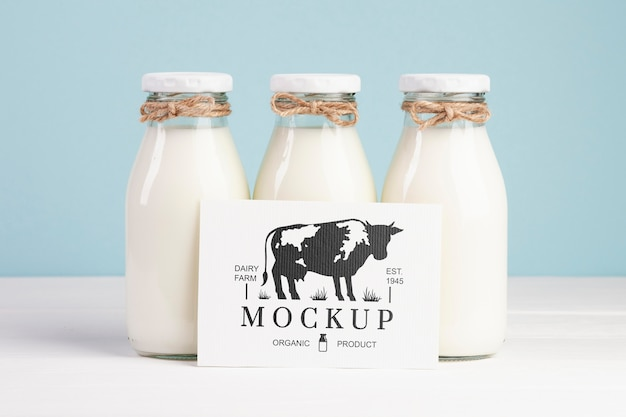 Dairy mock-up with milk bottles and placeholder Free Psd